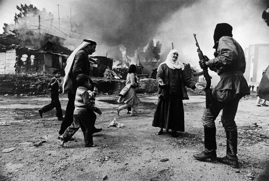"""Françoise Demulder, """"Lebanese Civil War. Quarantine camp. Palestinians. Christian militia. Beirut. January 19, 1976"""". © Françoise Demulder/Roger-Viollet/The Image Works"""