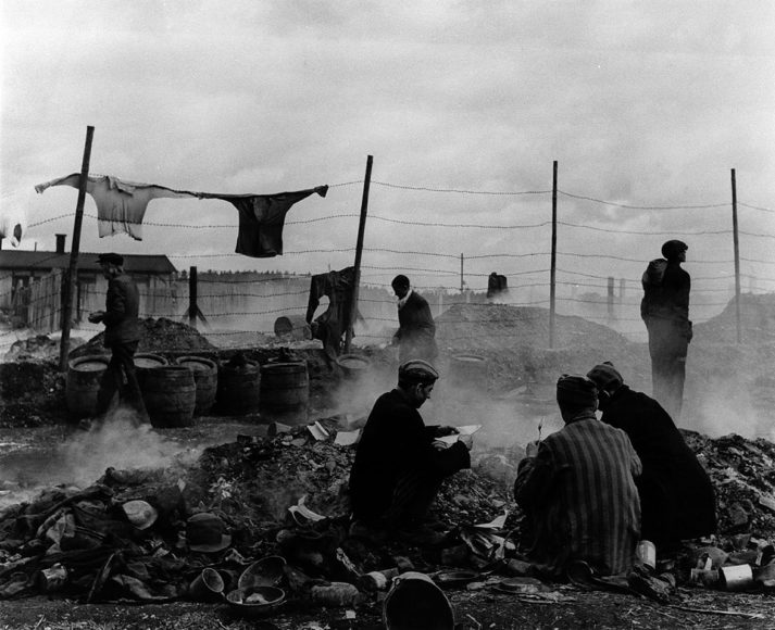 """Lee Miller, """"Freed prisoners scavenging in the rubbish dump, Dachau, Germany, 1945"""". © Lee Miller Archives"""