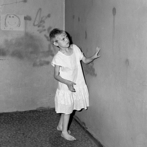 Girl in white dress, 2002 / © Roger Ballen