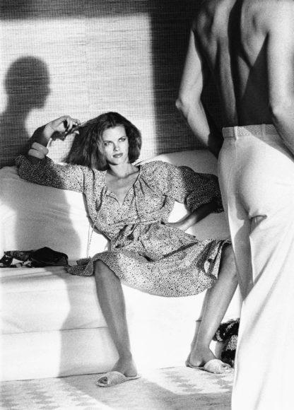 Helmut Newton, Woman examining Man, Calvin Klein, US Vogue, St. Tropez 1975 © Helmut Newton Estate, courtesy Helmut Newton Foundation.